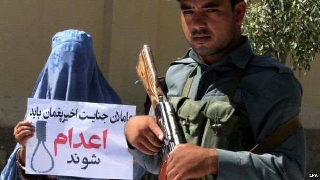 An Afghan woman holds a placard reading in Darri Be executed during a protest against a high-profile gang rape case that shocked the capital Kabul, in Herat, Afghanistan, 08 September 2014