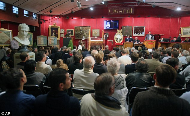 Sold! The hat was bought for £1.5million at a packed auction at Fontainebleau, near Paris, today (above)