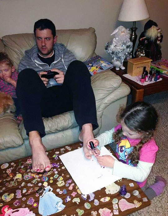 Letting His Daughter Do His Nails While Playing A Video Game