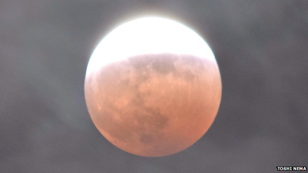 Eclipse from Tokyo by Toshi Nema