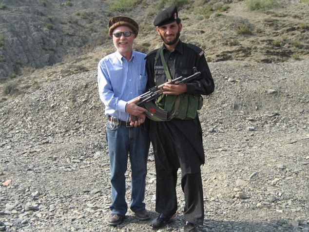 Donald Parrish poses with a Pakistani Soldier in Khyber Pass in 2006. Mr Parrish has visited 840 of the worlds 875 recognised destinations