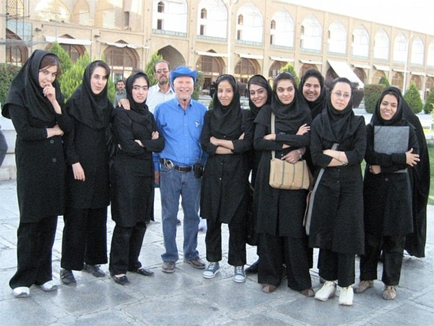 Donald poses with Nine Virgins in Isfahan, Iran in 2006.During his life, Mr Parrish has discovered that he has spent a total of eight years outside of the US traveling or working