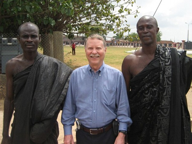 Don stands at the Court of the Ashanti King in Kumasi, Ghana in 2007.He travels about six months a year, often alone but sometimes with one or two others to share the costs