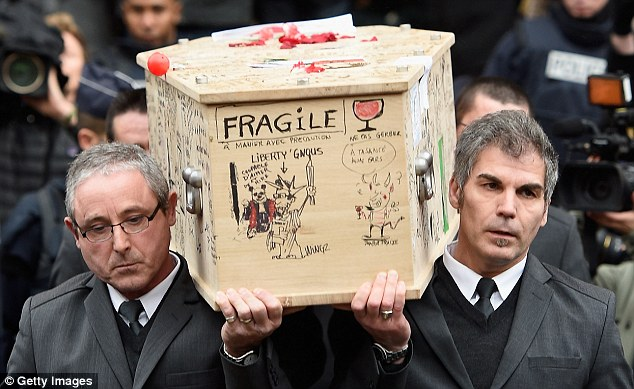 Fragile: Friends and former colleagues of Tignous wrote humorous messages and drew caricatures and cartoons on the coffin during the service