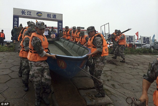 Strong rains and winds are said to be hampering the huge search effort, local media reported