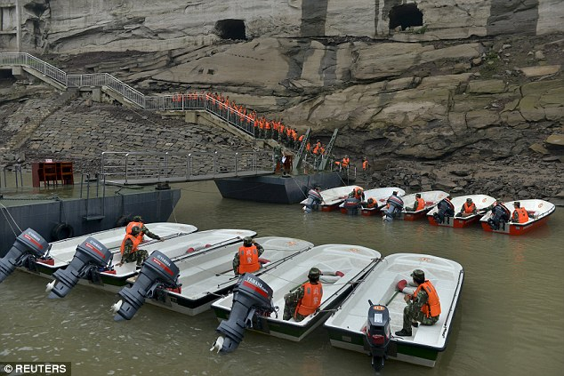 Hundreds of rescuers quickly assembled at the scene as well as submersible craft and speedboats