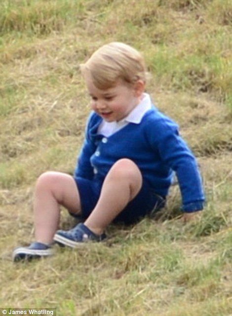 George, who is becoming a fashion icon in his own right was dressed in an £64 Olivier cardigan and black Crocs, £26.99