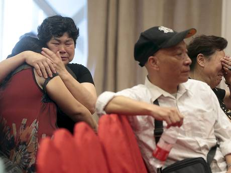 Relatives of passengers on the ship that sank at Jianli section of Yangtze River