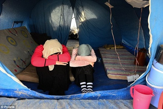 The girls were routinely stripped naked before being categorized and shipped off. Above, Yazidi women who managed to escape from ISIS earlier this year