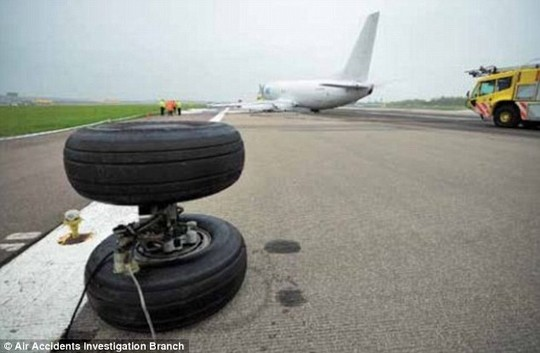 The cargo planes left main landing gear detached due to heat damage to chrome plating, a report said