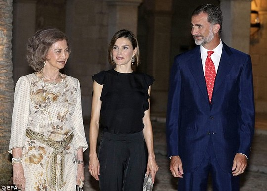 Family affair: She was joined last night by mother-in-law Queen Sofia (left) and husband King Felipe