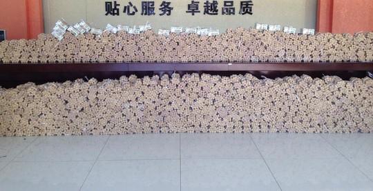 Toàn bộ số tiền xu được trạm xăng ông Gan tích trữ trong 3 tháng. Ảnh: news.qq.com