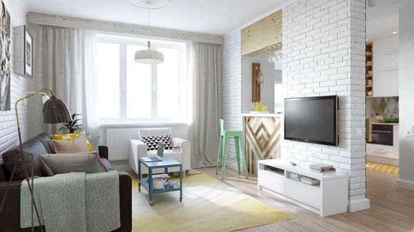 Khu vực tiếp khách và bếp của căn hộ này được phân chia bằng một quầy bar nhỏ và một bức tường decor rất đẹp mắt, tạo không gian thoáng mát cho căn bếp.