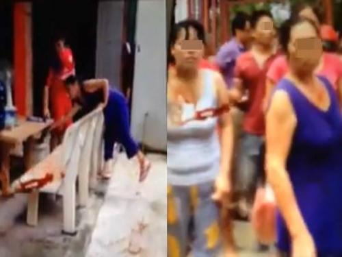 Theo hình ảnh được ghi lại, có nhiều người cùng có những hành động chửi bới, đánh đập cô gái trong clip (ảnh cắt từ clip)