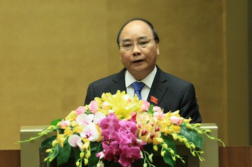Thủ tướng Chính phủ Nguyễn Xuân Phúc báo cáo trước Quốc hội sáng 20/10. Ảnh: CP