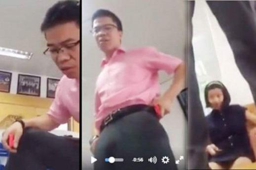 Ông Phan Văn Hưng có hành động đứng lên bàn dùng lời lẽ thô tục chửi học sinh (ảnh cắt từ clip)