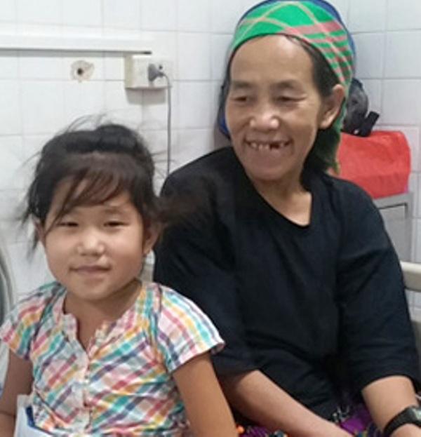 Mẹ con bé Ly Thị Lúa.