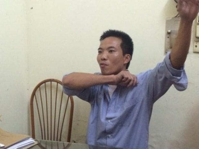 Lê Xuân Thuận tại cơ quan công an. Ảnh: Hoàng Phong