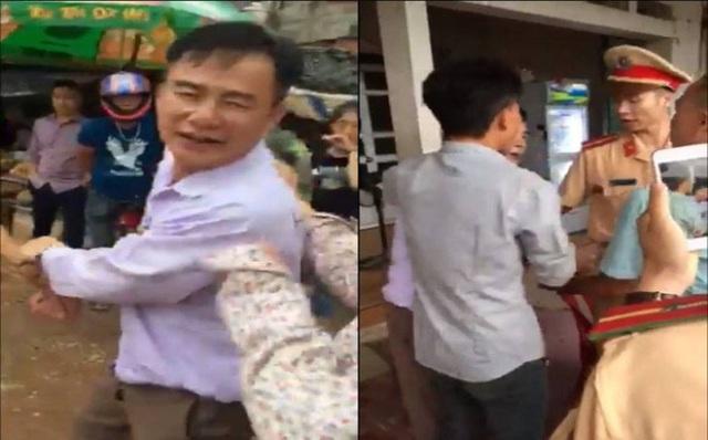 Sau khi xuống xe, ông Hữu có biểu hiện say rượu đã chửi bới người dân và lực lượng chức năng. Ảnh: Cắt từ clip