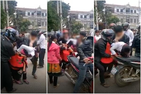 Hình ảnh cô gái bị bắt ép lên xe đến tuột cả váy. Ảnh cắt từ clip