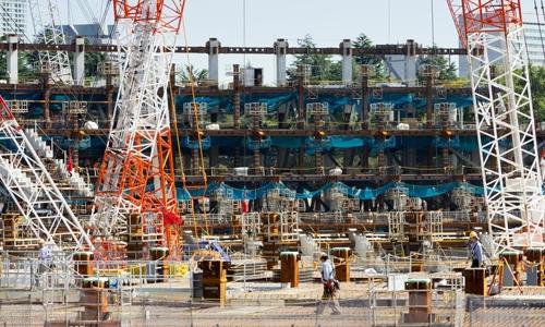 Công trường xây dựng sân vận động Olympic ở Gaiemmae, Tokyo. Ảnh: Barcroft