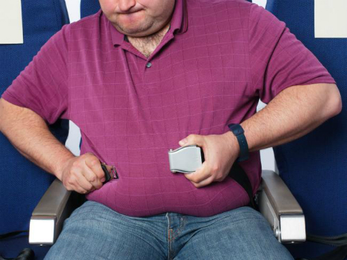 Một số hãng hàng không cũng có quy định về cân nặng của hành khách. Ảnh: istock.