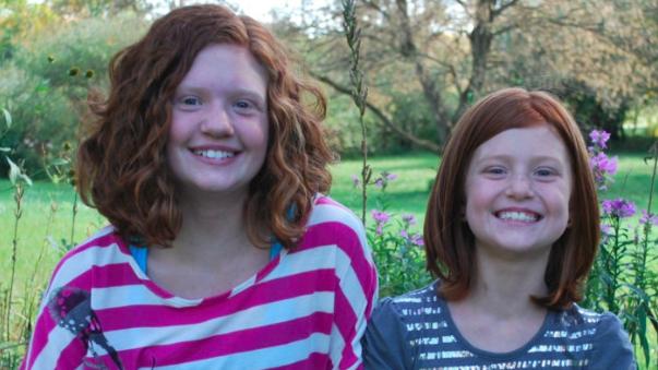 Hai cô con gái xinh đẹp của Scott (Ảnh: Scary Mommy)