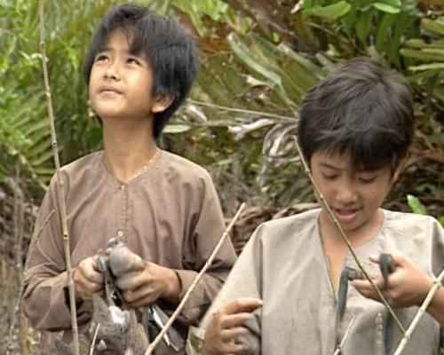 Hai cậu bé An và Cò trong Đất phương Nam.