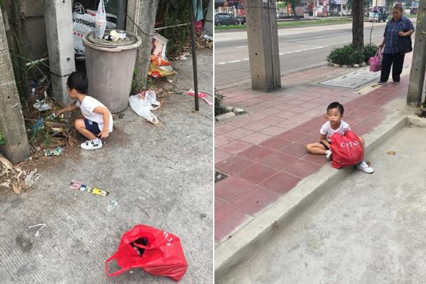 Cậu bé chăm chỉ nhặt rác và ngồi bệt xuống đất vì mệt.