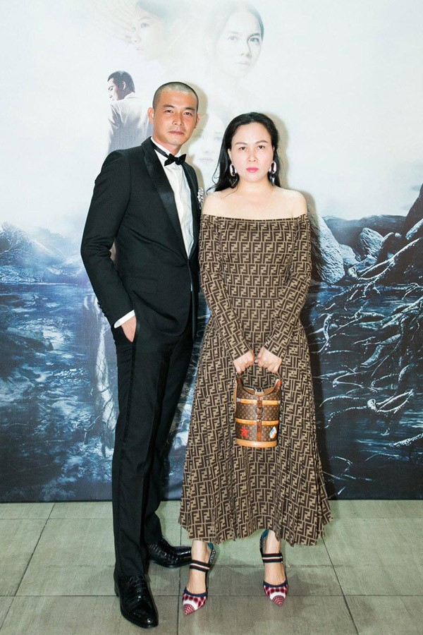 Quách Ngọc Ngoan và doanh nhân Phượng Chanel trong buổi công chiếu phim Người bất tử tại TP HCM hôm 16/10.
