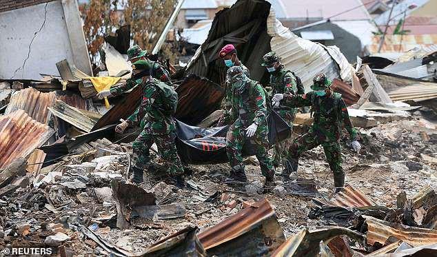 Lực lượng cứu hộ đang gặp khó khăn trong công tác tìm thi thể.