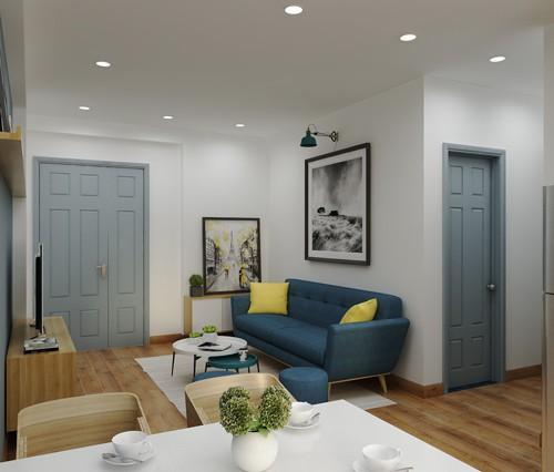 Trước tiên, nhóm kiến trúc sư quyết định sơn toàn bộ lại màu trắng để khiến nhà sáng đẹp và có cảm giác rộng hơn. Họ thiết kế nội thất hướng đến phong cách Scandinavia (phong cách nội thất Bắc Âu), đơn giản, nhẹ nhàng nhưng tinh tế. Màu xanh đậm của ghế sofa, xanh pastel của cánh cửa rất hài hòa với màu tường, gỗ.