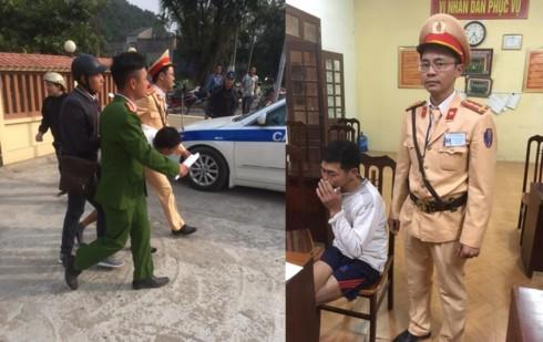Đối tượng bị cảnh sát khống chế đưa về trụ sở cơ quan công an.