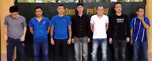 7 nghi can trong đường dây tín dụng đen đang bị tạm giam tại Thanh Hoá. Ảnh: C.A.
