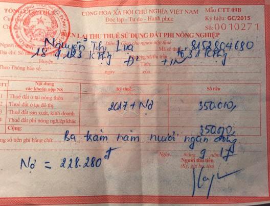 Thông báo nộp thuế của Chi cục Thuế quận Đống Đa và Biên lai thu thuế sử dụng đất phi nông nghiệp của gia đình bà Lụa