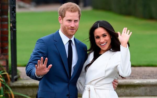 Hoàng tử Harry và hôn thê Meghan Markle. Ảnh: Eddie Mulholland