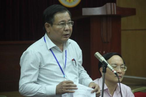 Ông Lê Ngọc Quang thông báo với báo chí về vụ lọt đề tại cuộc họp báo ngày 7-6