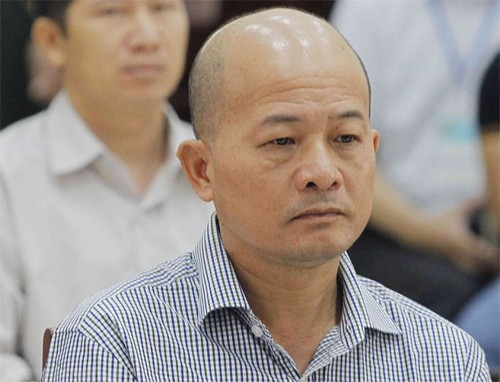 Bị cáo Đinh Ngọc Hệ tại tòa: Ảnh: TTXVN.