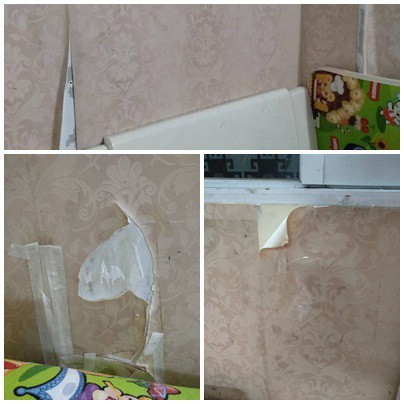 Giấy dán bung ra khiến tường nham nhở. Những vết bẩn trên giấy khó vệ sinh sạch.