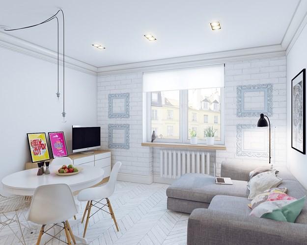 Dù chọn màu trắng làm gam màu chủ đạo nhưng chủ nhân căn hộ vẫn không quên điểm xuyết một vài màu sắc cho phần gối tựa hay tranh treo tường.