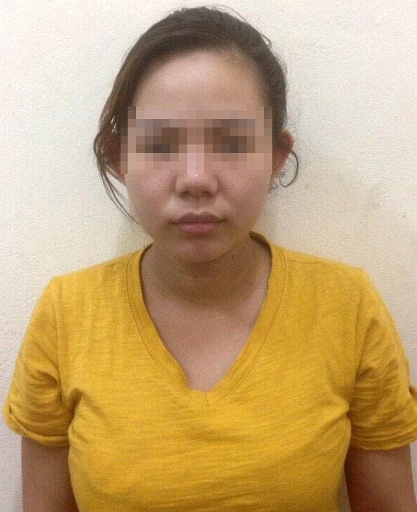 Phan Thị Trinh tại cơ quan công an. Ảnh: T.L.