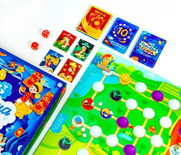 """""""Cuộc Đua Cổ Tích"""" có một bản đồ đường đua với bốn nhân vật khác nhau, người chơi sẽ thay phiên tung xúc xắc để quyết định số bước tiến của mỗi lượt đi."""