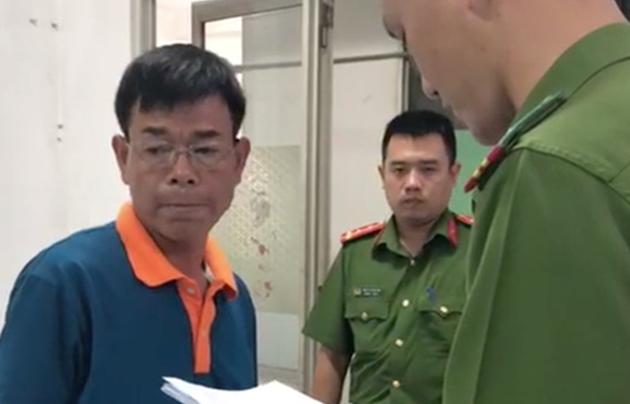 Khám xét nơi làm việc của ông Nguyễn Hải Nam Phó chánh án TAND Q.4 - Ảnh 1.