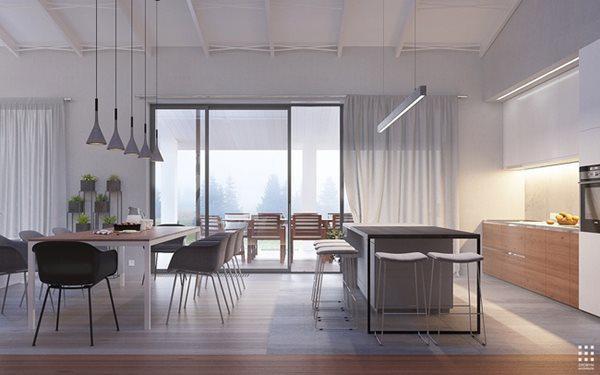 Hệ thống cửa kính mang lại nguồn sáng tự nhiên cho ngôi nhà, cùng hệ thống đèn vàng mang lại cảm giác ấm áp cho căn bếp.