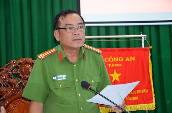 Đại tá Cầu tại buổi họp báo. Ảnh: Tuổi trẻ