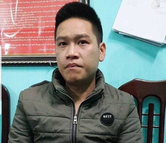 Đối tượng Bùi Quang Huy tại cơ quan cảnh sát điều tra.