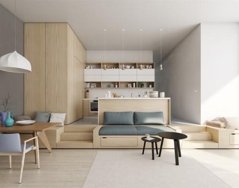 Việc đẩy cao phần sàn gỗ nhà bếp giúp nó tách biệt với phòng khách mà không cần đến một bức tường ngăn nào.