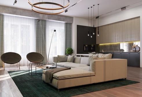 Một tấm thảm lớn cùng ghế sofa đánh dấu khu vực tiếp khách.