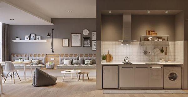 Máy giặt được tận dụng dưới khu bếp, cạnh đó khu thư giãn.
