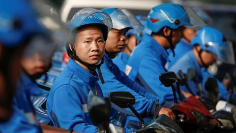 Hầu hết tài xế đều xác định đây không phải là công việc lâu dài. Ảnh: Reuters.